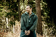Man golfing in the wilderness in Polebridge, Montana.