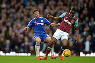 Cesar Azpilicueta of Chelsea and Diafra Sakho of West Ham United in action. Barclays Premier League, West Ham Utd v Chelsea at The Boleyn Ground, Upton Park in London on Saturday 24th October 2015.<br /> pic by John Patrick Fletcher, Andrew Orchard sports photography.