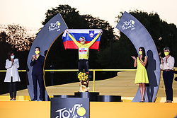 Mayor of Paris Anne Hidalgo (left) and UAE's rider Tadej Pogacar winner of the yellow jersey of overall winner on the podium of the Tour de France 2020, on Champs Elysees Avenue in Paris, on September 20, 2020. / Sportida