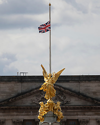 © Licensed to London News Pictures.09/04/2021. London, UK. The Union Flag flies at half mast above Buckingham Palace following an announcement regarding the death of Prince Philip. Buckingham Palace has announced that Prince Philip The Duke of Edinburgh passed away this morning at Windsor Castle . Photo credit: George Cracknell Wright/LNP