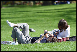 April 17, 2018 - London, London, United Kingdom - Sunshine in London. St James's Park...A couple relax in the heat as people flock to London's St James's Park to take advantage of sunny spell in the Capital. (Credit Image: © Pete Maclaine/i-Images via ZUMA Press)