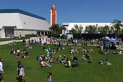 """From the Kennedy Space Center Visitor Complex, guests joined Americans from coast to coast following the solar eclipse. Although a partial eclipse on Florida's Space Coast, young and old alike found many ways to watch the rare astronomical event. As the Moon passed between Earth and the midafternoon Sun, a shadow moved across the landscape. The 70-mile-wide totality path, or """"umbral cone"""" -- where the entire Sun will vanish behind the Moon -- stretched across 14 states, from Oregon to South Carolina.  Photo credit: NASA/Ben Smegelsky<br />   Please note: Fees charged by the agency are for the agency's services only, and do not, nor are they intended to, convey to the user any ownership of Copyright or License in the material. The agency does not claim any ownership including but not limited to Copyright or License in the attached material. By publishing this material you expressly agree to indemnify and to hold the agency and its directors, shareholders and employees harmless from any loss, claims, damages, demands, expenses (including legal fees), or any causes of action or allegation against the agency arising out of or connected in any way with publication of the material."""
