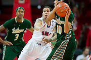 DALLAS, TX - JANUARY 15: Nic Moore #11 of the SMU Mustangs defends Josh Heath #10 of the South Florida Bulls on January 15, 2014 at Moody Coliseum in Dallas, Texas.  (Photo by Cooper Neill/Getty Images) *** Local Caption *** Nic Moore