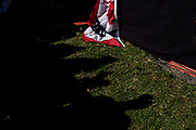 """The shadow of a participants appears on the ground during Bernie Sander's """"Bernie's Back"""" Rally on October 19, 2019 at Queenbridge Park in Long Island City, NYC."""