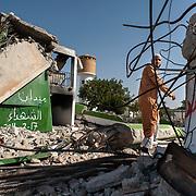 A man enters the Benghazi katiba, the former secret prison of Colonel Gaddafi, whose perimeter wall was blown out by a suicide bomber car filled with explosives in the early hours of the popular uprising that will turn into a civil war. Benghazi on March 4, 2011.  Photograph Arnaud Finistre / Hans Lucas<br /> Un homme pénètre dans la katiba de Benghazi, l'ancienne prison secrète du colonel Kadhafi dont le mur d'enceinte a été éventré par une voiture kamikaze remplie d'explosifs aux premières heures du soulèvement populaire qui tournera en guerre civile. Benghazi le 4 mars 2011. Photographie Arnaud Finistre / Hans Lucas