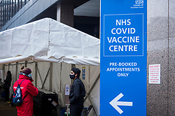 © Licensed to London News Pictures. 15/02/2021. LONDON, UK.  People at the entrance to the mass vaccination centre at the Olympic Office Centre in Wembley, north London.  Over the weekend, the UK government achieved its target of administering 15 million Covid-19 first doses by 15 February and the goal now is to vaccinate everyone over aged 50 by the end of April.  Photo credit: Stephen Chung/LNP
