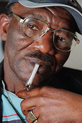Portrait of man smoking cigarette,