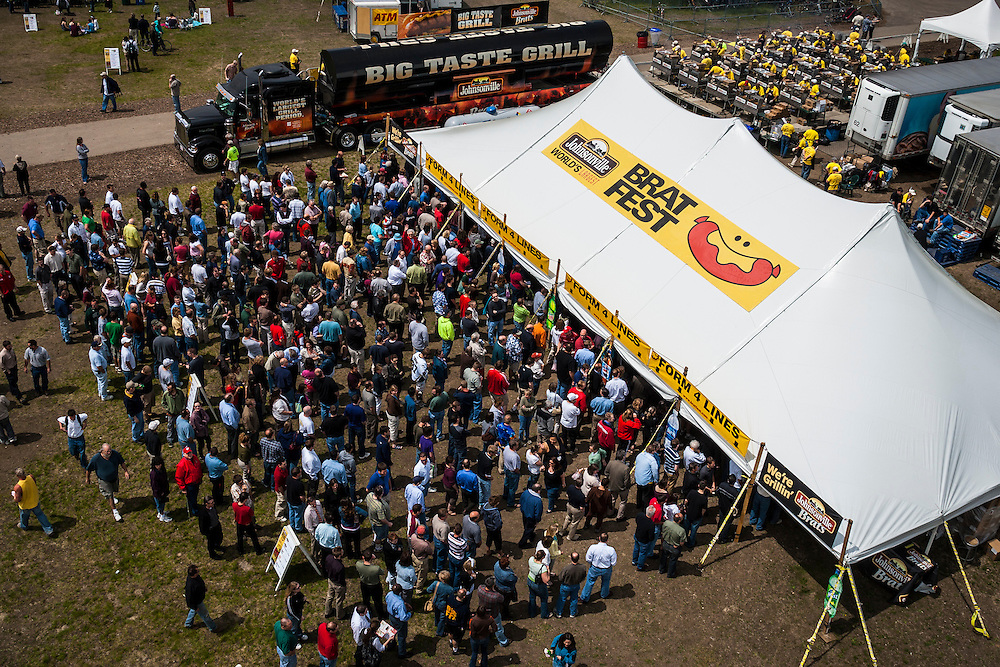 People line up for bratwursts at annual Brat Fest over the Memorial Day weekend in Madison, Wis. About 100 brats will be eaten each minute.(Photo © Andy Manis) (Photo © Andy Manis)