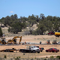061914       Cable Hoover<br /> <br /> Construction Crews work on the foundation of a new jail for Ramah Navajo Police north of Mountain View Thursday.