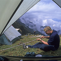 Cordillera Vilcabamba, Andes Mountains, Peru. Ben Wiltsie carves a walking stick during National Geographic archaeology expedition to Cerro Victoria.