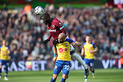 West Ham United's Manuel Lanzini and Southampton's Nathan Redmond battle for the ball during the Premier League match at the London Stadium.,