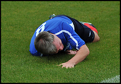 Shadow Chancellor Ed Balls falls over during the Labour Politicians v Reporter's Football match during the Labour Party Autumn Conference. Sunday, 22nd September 2013. Picture by Andrew Parsons / i-Images