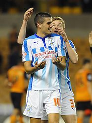 Huddersfield Town's goalscorer, Conor Coady celebrates with Huddersfield Town's Paul Dixon - Photo mandatory by-line: Dougie Allward/JMP - Mobile: 07966 386802 - 01/10/2014 - SPORT - Football - Wolverhampton - Molineux Stadium - Wolverhampton Wonderers v Huddersfield Town - Sky Bet Championship