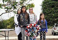 From left in front, Taylor and Brianna Baughman hold a ceremonial wreath on Memorial Day at the Monterey County Vietnam Veterans Memorial in Salinas. At left in back are Deneice Clay and Stefanie Baughman.