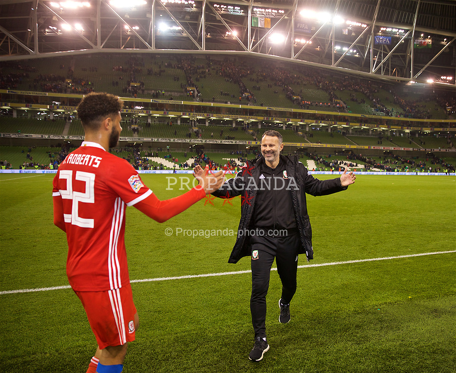DUBLIN, IRELAND - Tuesday, October 16, 2018: Wales' manager Ryan Giggs celebrates with Tyler Roberts after the 1-0 victory during the UEFA Nations League Group Stage League B Group 4 match between Republic of Ireland and Wales at the Aviva Stadium. (Pic by David Rawcliffe/Propaganda)