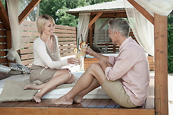 Holiday relaxing drinking cocktail couple romantic
