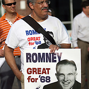 A protester carries a sign as he marches in a parade during the Republican National Convention in Tampa, Fla. on Wednesday, August 29, 2012. (AP Photo/Alex Menendez)