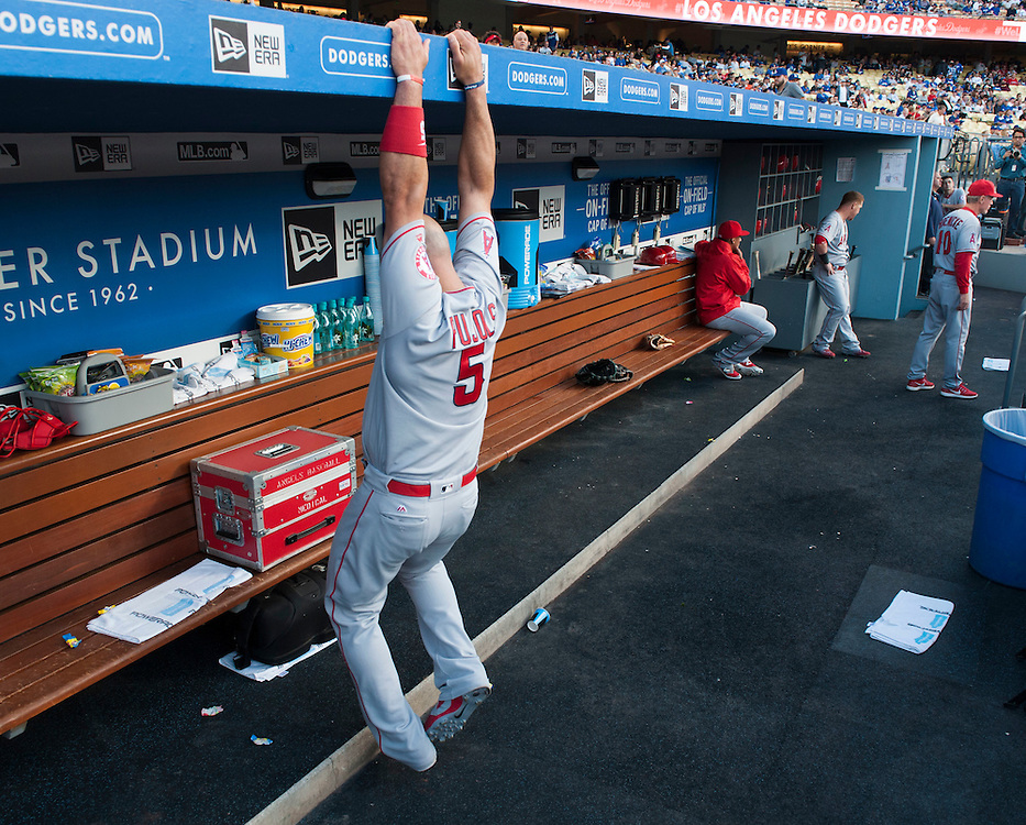 The Angels' Albert Pujols stretches out in the dugout before the Angels loss Tuesday night at Dodger Stadium.<br /> <br /> / //ADDITIONAL INFO:   <br /> <br /> angels.0518.kjs  ---  Photo by KEVIN SULLIVAN / Orange County Register  -- 5/17/16<br /> <br /> The Los Angeles Angels take on the Los Angeles Dodgers in inter-league play at Dodger Stadium Tuesday night.