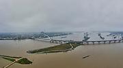 Nederland, Gelderland, Nijmegen, 04-002-2021; Hoog water in de Rijn, ten gevolge van regen en smeltwater bij de bovenloop van de rivier, zorgt voor hoge waterstanden. Ook het peil van de Waal bij Nijmegen is hoog. Het water wordt nu ook afgevoerd via de nieuw aangelegde nevengeul, de Spiegelwaal (bij Lent).<br /> High water in the Rhine, as a result of rain and meltwater at the upper course of the river, causes high water levels. The level of the Waal near Nijmegen is also high. The water is now also discharged via the newly constructed side channel, the Spiegelwaal (near Lent).<br /> <br /> drone-opname (luchtopname, toeslag op standaard tarieven);<br /> drone recording (aerial, additional fee required);<br /> copyright foto/photo Siebe Swart