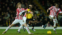 Photo: Leigh Quinnell.<br /> Watford v Stoke City. Coca Cola Championship.<br /> 14/01/2006. Watfords Al Bangura stretches to take the ball from Stokes Paul Gallagher(L)