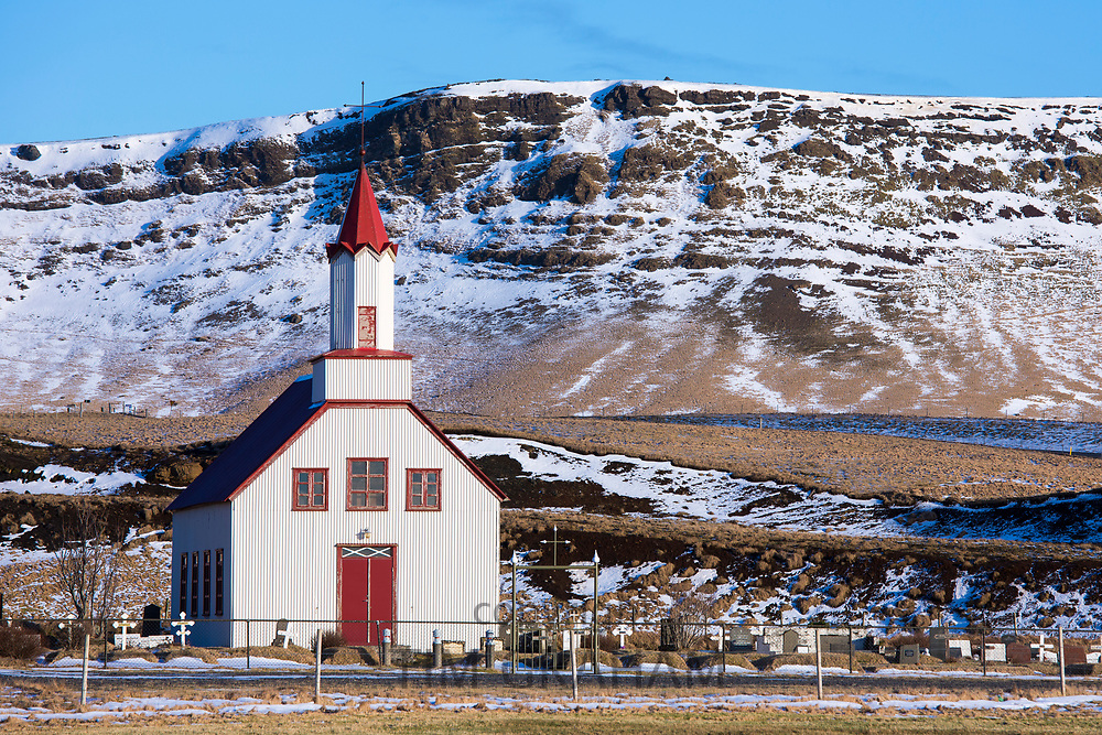 Traditional quaint Icelandic wooden church on a hill in the village Vík i Myrdal, South Iceland