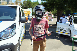 July 4, 2018 - Odesa, Ukraine - A boy in a helmet wears a gas mask and holds a baton during the celebration of the National Police Day in the Taras Shevchenko Park, Odesa, southern Ukraine, July 4, 2018. Ukrinform. (Credit Image: © Nina Liashonok/Ukrinform via ZUMA Wire)