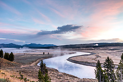Hayden Valley sunrise from Grizzly Overlook with the Yellowstone River winding through the valley below. Yellowstone National Park.