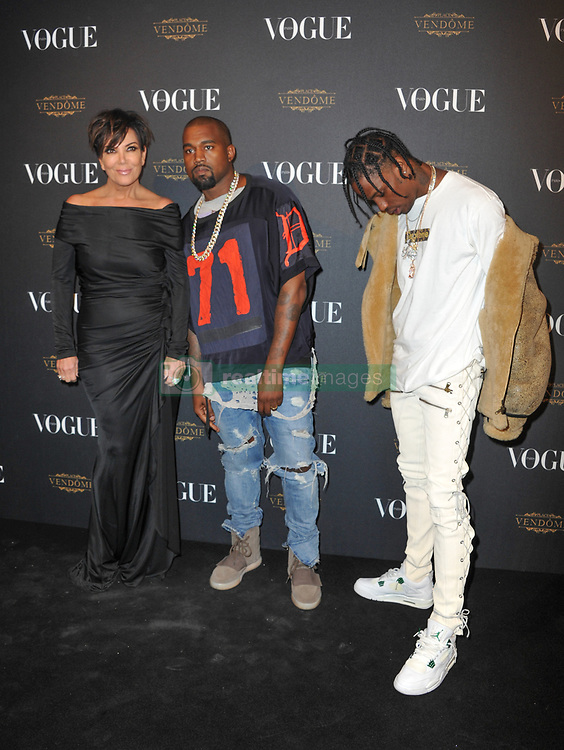 Kris Jenner, Kanye West and Travis Scott posing at the photocall during the 95th anniversary party of Vogue magazine held Avenue d'Iena in Paris, France on October 3, 2015. Photo by Alban Wyters/ABACAPRESS.COM  | 518256_013 Paris France