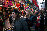 Crowds of people squeeze into a narrow street Chinatown during Chinese New Year celebrations in central London, United Kingdom. Tens of thousands of people gathered in the West End filling the streets and joining in with the festival atmosphere. (photo by Mike Kemp/In Pictures via Getty Images)