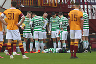 Celtic players look down upon an injured Jeremie Frimpong (Celtic) during the Scottish Premiership match between Motherwell and Celtic at Fir Park, Motherwell, Scotland on 8 November 2020.