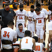 Gallup Bengals head coach Joshua Dunlap talks to the Bengals during a time out in a basketball game against the Miyamura Patriots Tuesday evening at Gallup High School in Gallup.