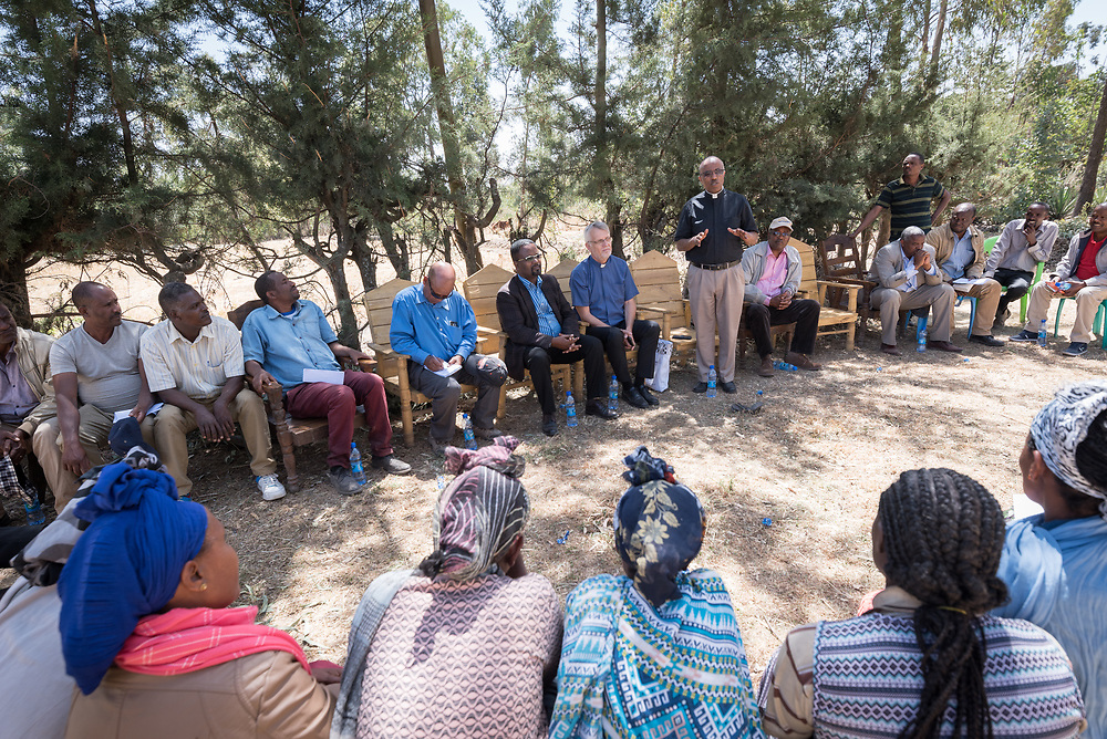 31 January 2019, Southern Nations, Nationalities, and Peoples' Region, Ethiopia: EECMY president Rev. Yonas Dibisa meets with members of the Tesfa ('hope') self-help group for women, which undertakes community banking to raise women's economic status and independence. Through the Mekane Yesus Food Security Project for Lemo Community, the Ethiopian Evangelical Church Mekane Yesus' development wing Development and Social Services Commission helps women raise their socio-economic status through community banking efforts and education, and helps improve communities' food security through training in agricultural methods suitable in a changing climate.