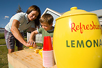 A young woman sets up a lemonade stand with her son in Jackson Hole, Wyoming.