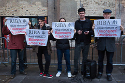 London, UK. 8 October, 2019. Campaigners from Architects for Social Housing (ASH) protest outside the award ceremony for the Riba Stirling Prize at the Roundhouse. They were protesting against the Royal Institute of British Architects' (RIBA) nomination of the architecture of social cleansing, estate demolition and housing privatisation for the Stirling Prize, against the false promotion of council-owned commercial housing development and management companies as a so-called 'renaissance in social housing' and against the association of the name of socially committed architect, the late Neave Brown, with the architecture of Neo-liberalism. Credit: Mark Kerrison/Alamy Live News