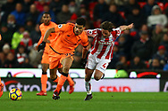 Dominic Solanke of Liverpool (l) and Joe Allen of Stoke City battle for the ball. Premier league match, Stoke City v Liverpool at the Bet365 Stadium in Stoke on Trent, Staffs on Wednesday 29th November 2017.<br /> pic by Chris Stading, Andrew Orchard sports photography.