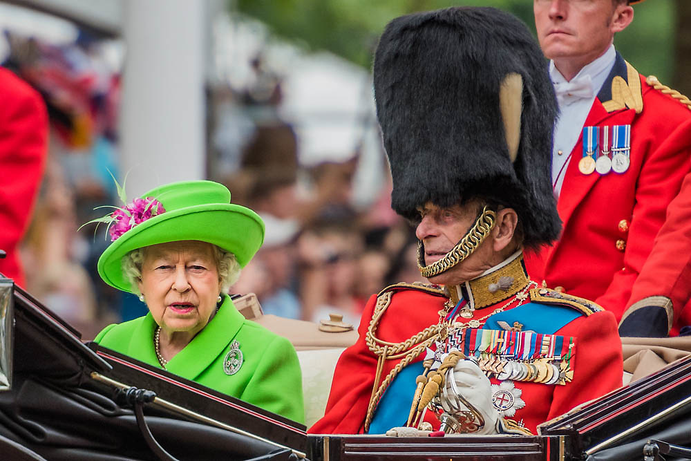 The Queen and Prince Phillip pass down the mall - Queens 90th birthday was celebrated by the tradition Trooping the Colour as well as a flotilla on the river Thames.