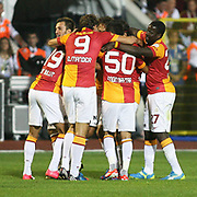 Galatasaray's players ,Emmanuel Eboue,Engin Baytar,Johan Elmander,Umut Bulut are happy after a goal on their Turkish Super Cup 2012 soccer derby match Galatasaray between Fenerbahce at the Kazim Karabekir stadium in Erzurum Turkey on Sunday, 12 August 2012. Photo by TURKPIX
