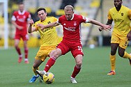 Aberdeen's Dylan McGeouch (15) battles for possession, tussles, tackles, challenges, during the Scottish Premiership match between Livingston and Aberdeen at Tony Macaroni Arena, Livingstone, Scotland on 1 May 2021.