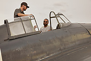 Pilots talking about Erickson Aircraft Collection's FM-2 Wildcat at Warbirds Over the West.