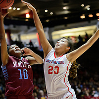 031015  Adron Gardner/Independent<br /> <br /> Sandia Prep Sun Devil Kalei Yepa (10), left, releases a shot under pressure from Shiprock Chieftain Tanisha Begay (23) during the New Mexico state basketball tournament at The Pit in Albuquerque Tuesday.  The Chieftains beat the Sun Devils 61-50.