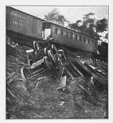 A military train upset by Confederates from the book ' The Civil war through the camera ' hundreds of vivid photographs actually taken in Civil war times, sixteen reproductions in color of famous war paintings. The new text history by Henry W. Elson. A. complete illustrated history of the Civil war