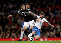 Argentina's Gonzalo Higuain (left) and Italy's Marco Verratti (right) battle for the ball