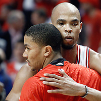 10 May 2011: Chicago Bulls forward Taj Gibson (22) congrats Chicago Bulls point guard Derrick Rose (1) after the Chicago Bulls 95-83 victory over the Atlanta Hawks, during game 5 of the Eastern Conference semi finals at the United Center, Chicago, Illinois, USA.