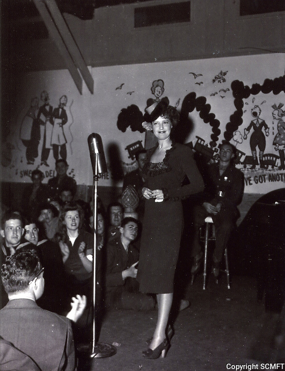 1944 Jeanette MacDonald entertains at the Hollywood Canteen