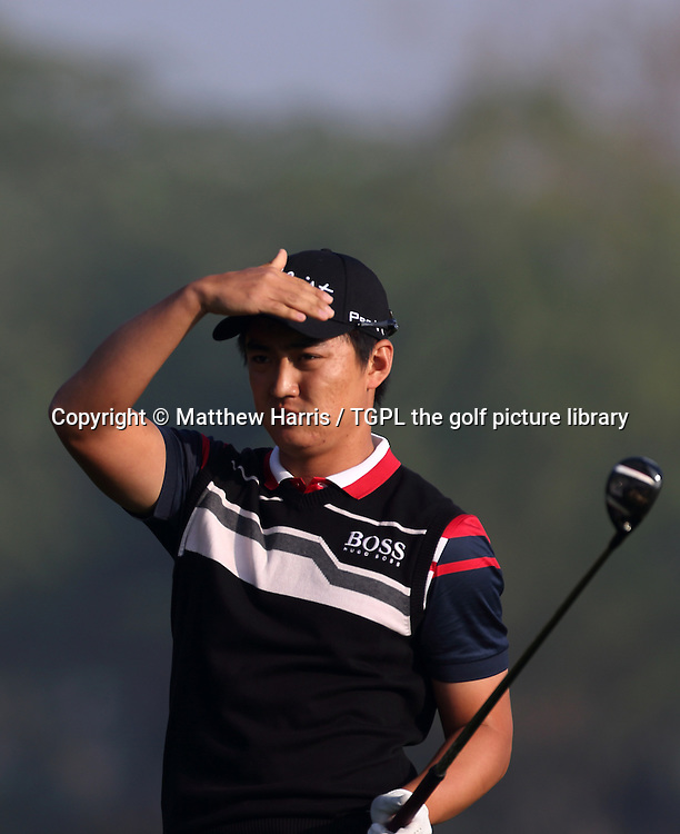 Jin JEONG (KOR) during first round Commercialbank Qatar Masters 2014,Doha Golf Club,Doha,Qatar.