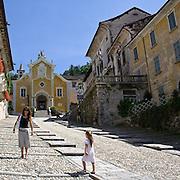 """Parrocchia Santa Maria Assunta sullo sfondo di via Albertoletti conosciuta coma la """"Salita della Motta""""<br /> <br /> Santa Maria Assunta in background of Albertoletti street, known as """"La salita della Motta"""""""