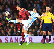 Cristiano Ronaldo of Portugal battles Martin Demichelis of Argentina - Argentina vs. Portugal - International Friendly - Old Trafford - Manchester - 18/11/2014 Pic Philip Oldham/Sportimage