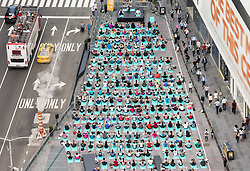 June 21, 2017 - New York, New York, U.S -  People participate in a yoga class in Times Square in honor of the solstice on the longest day of the year. (Credit Image: © Michael Brochstein via ZUMA Wire)