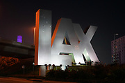 The LAX letters at the entrance to the Los Angeles International Airport, Sunday, Feb. 7, 2021, in Los Angeles. (Kirby Lee via AP)