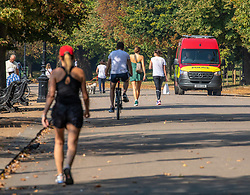 "© Licensed to London News Pictures. 15/09/2020. London, UK. Walkers enjoy the warm sunshine this morning as Police vans patrol Hyde Park enforcing the ""Rule of Six"" as the mini-heatwave continues in the South East of England with highs of 29c. Prime Minister Boris Johnson announced last week that gatherings of more than six people will be banned from Monday (yesterday) in the hope of reducing the coronavirus R number. The Rule of Six has already become unpopular with MPs and large families for being too strict. Photo credit: Alex Lentati/LNP"